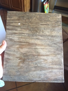 I grabbed a piece of scrap wood from the corner of the garage.